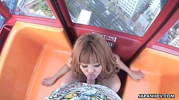 Asian bitch sucking a dick on a ferris wheel
