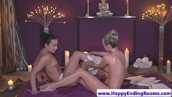Classy babe gets pussy fingered by masseuse