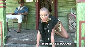 slickly-shaven head and sleek-shaven vulva of halloween cowgirl.