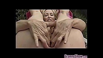 grandmother frigging her honeypot outdoors