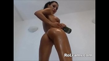 Teen with perfect body oiled up