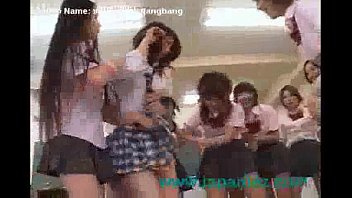 school women hold down fresh student and  her