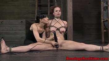 BDSM sub Bella Rossi feet caned