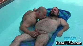 unshaved massive guys tugging stiffys by the pool.