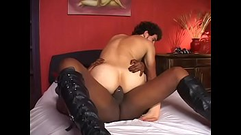 Guys sucks big black tranny cock on the bed