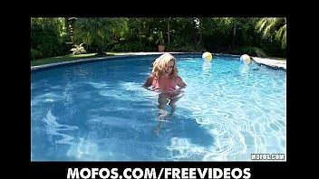 Big-tit bikini clad blonde fist fucks herself by the pool