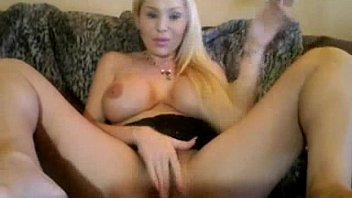 blonde slut with big fake boobs and a dildo
