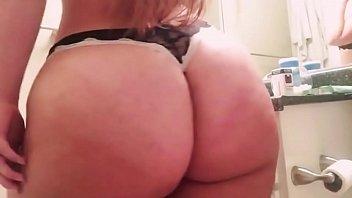 BBW big booty blonde brushing teeth in mirror with bra and panties