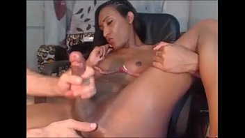 gives a handjob to a black shemale
