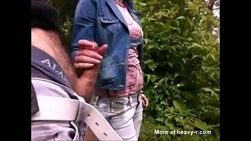 Girl jerks guy off outside - big cumshot