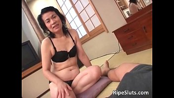Slutty horny mature Asian sucks on hard