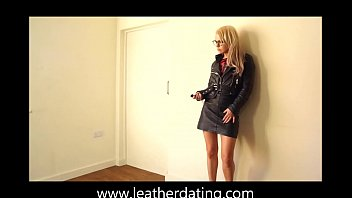 silver-blonde woman in dark-hued leather micro-skirt and leather.