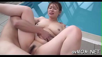 Asian milf gets partial hairless cunt hammered from behind