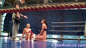 Lesbian babes enjoying naked wrestling