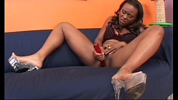 Ebony lesbian caught masturbating gets dildoed