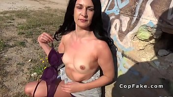 Brunette sucks fake cops huge dick in nature