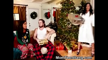 Brunette MILF And Teen Combination Christmas Morning Blowjob