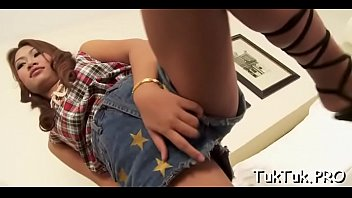 Thai gal blows her lover'_s jock until getting filled with cum