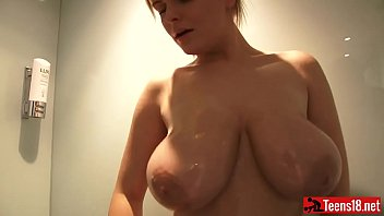 Sexy Blonde Bombshell with Big Boobs Takes a Sensual Shower