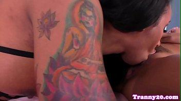 Tattooed ts pleasures her asian girlfriend