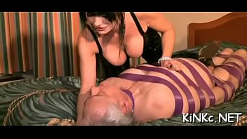 Merciless mistress chokes and kicks bound up slave in the balls