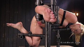 Blonde in device bondage anal fingered