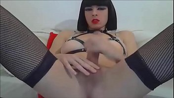 Beautiful tranny masturbates closeup