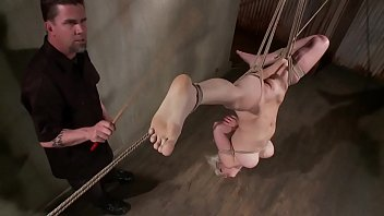 ash-blonde hung upside down by tormentor for his elation