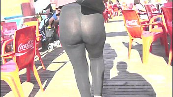 Booty sexy milf in the street with transparent legging,