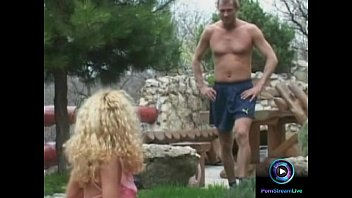 Curly haired blonde Jaqueline Stone giving a wet blowjob outdoors