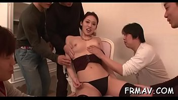 fantastic japanese playgirl massages her coochie.