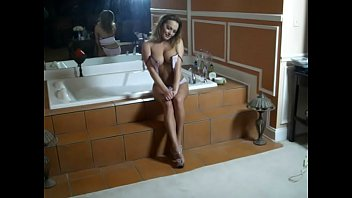 lindsey in our bathtub as mike south shoots.