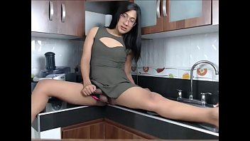 chinese ladyboy frolicking with her bone in the kitchen